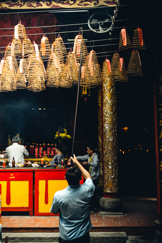 Suspending Incense Spirals | Ho Chi Minh City, Vietnam by Robert Metz