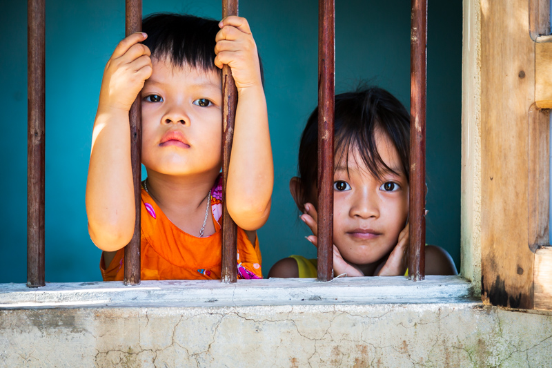 Kids look out of the Window | Hội An, Vietnam by Robert Metz