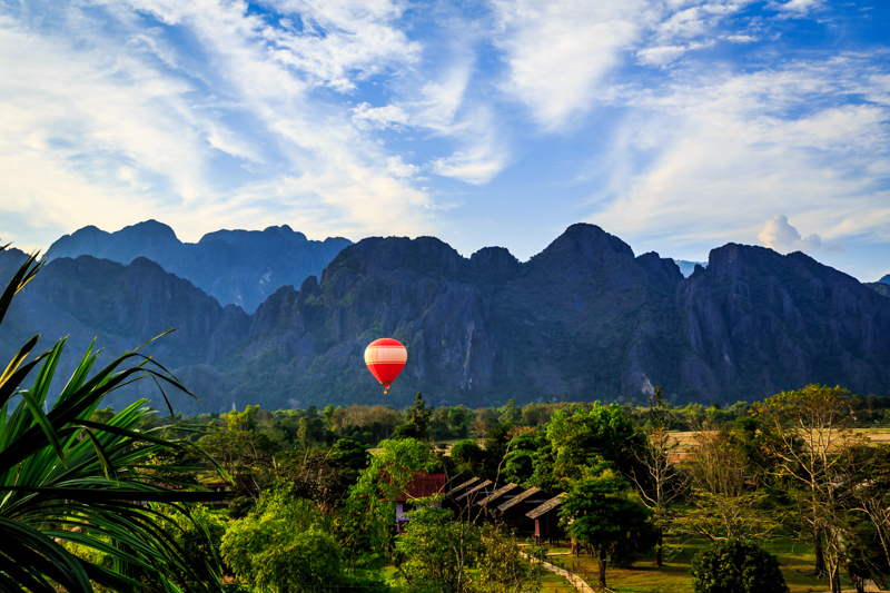 Hot-Air Balloon in front of Mountaines | Vang Vieng, Laos by Robert Metz